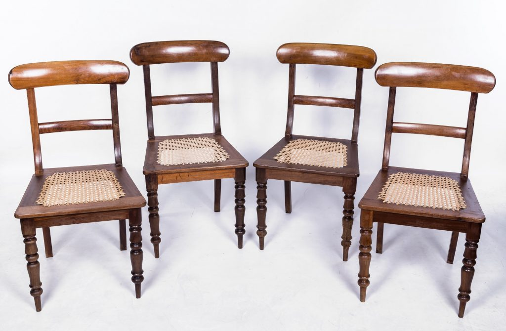 Four cane seated chairs from larger set