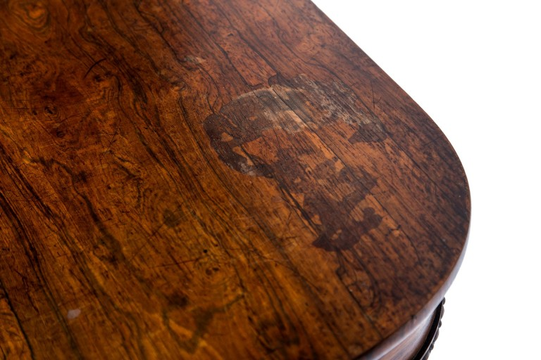 Staining to rosewood veneered table top